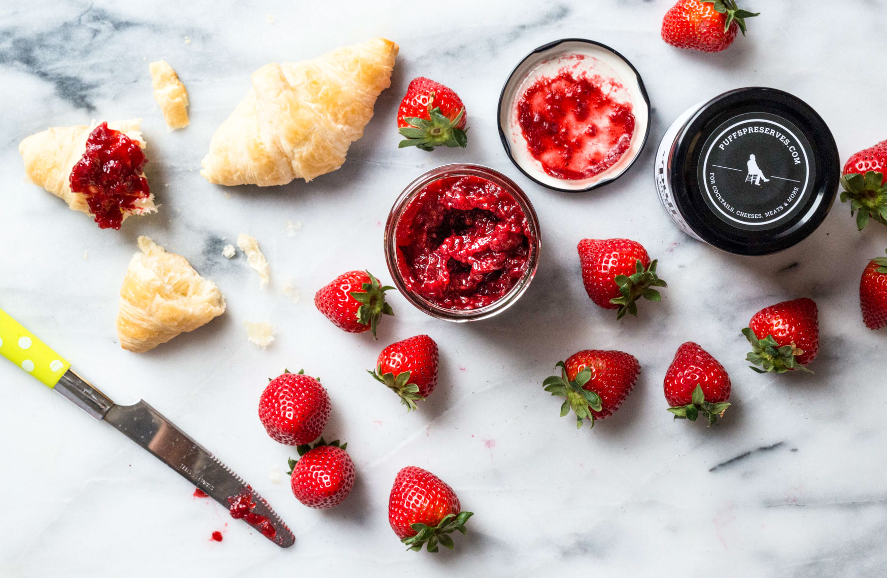 Strawberry Jam Compote with Croissant Spread on Marble Counter