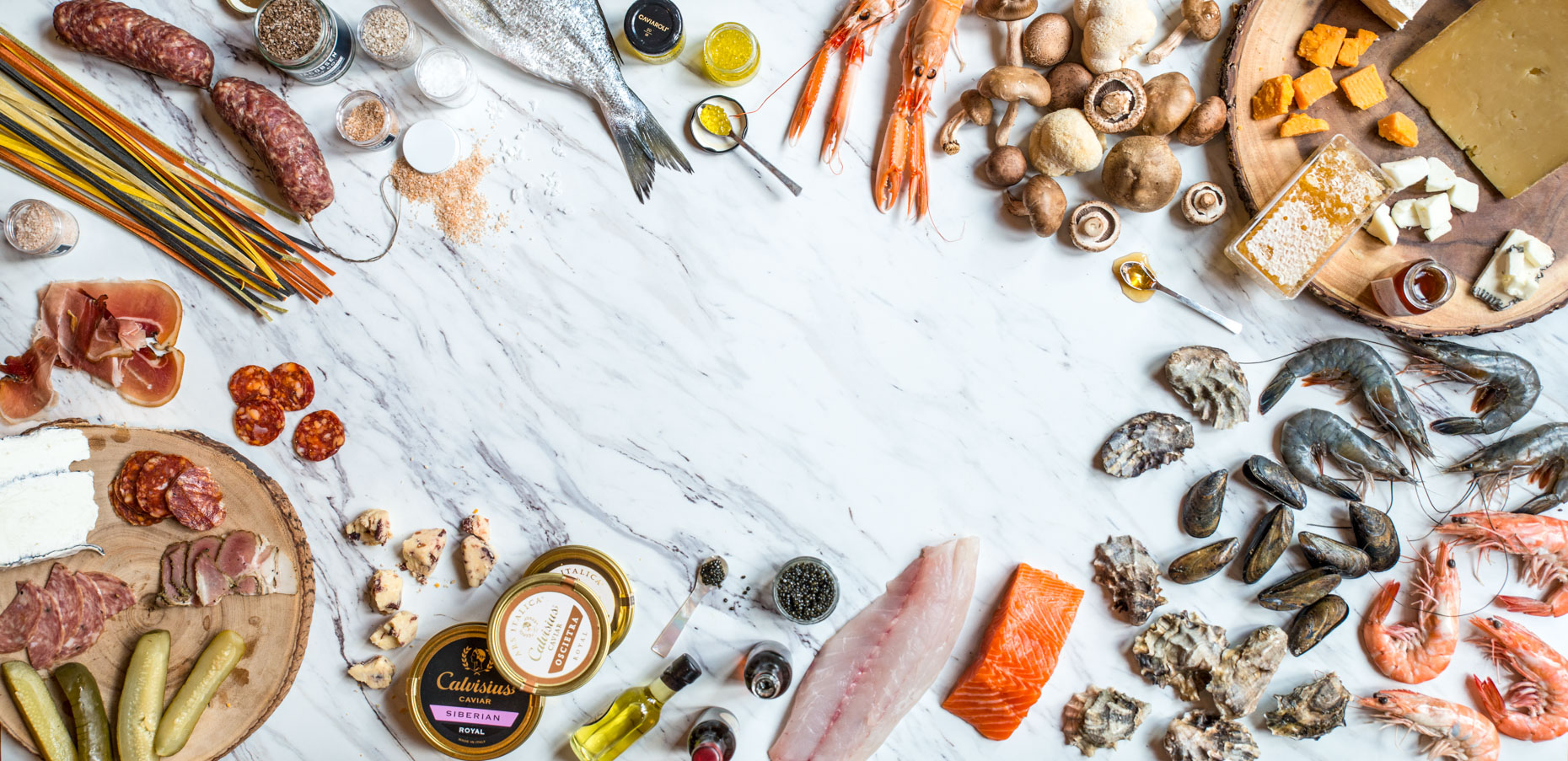 Seafood Ingredients and Gourmet Food Products on Marble Backdrop