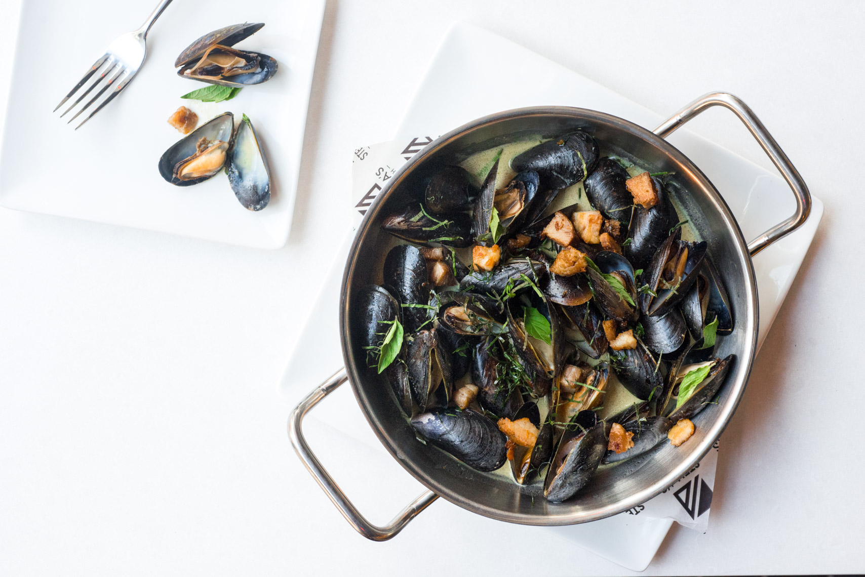 Pot of Mussels Moules Frites with Cilantro Garnish