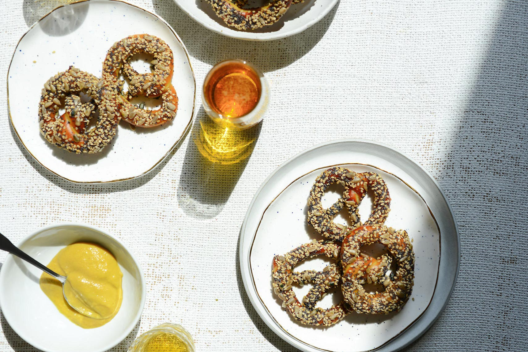 Large Pretzel Snacks on Plate with Beer and Mustard